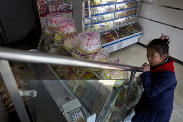 In this Feb. 16, 2013 photo, a North Korean girl stands inside a cake shop in Pyongyang, North Korea. (AP Photo/David Guttenfelder)