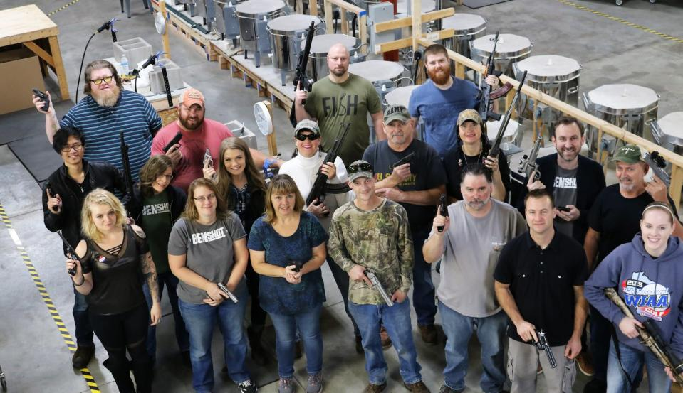 The owners of BenShot, a novelty glassware company in Wisconsin, gave their employees guns as a Christmas present. (Photo: Facebook/BenShot)
