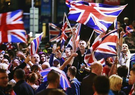 Pro-union protestors chant and wave Union Flags during a demonstration at George Square in Glasgow