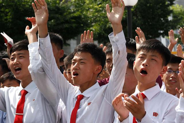 <p>People react as they watch the news that North Korean leader Kim Jong Un signed the order to carry out the test-fire of intercontinental ballistic rocket near the Pyongyang railway station in Pyongyang, North Korea, Tuesday, July 4, 2017. (Photo: Jon Chol Jin/AP) </p>