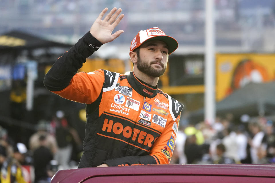 Chase Elliott waves to fans as he is introduced before a NASCAR Cup Series auto race at Bristol Motor Speedway Saturday, Sept. 18, 2021, in Bristol, Tenn. (AP Photo/Mark Humphrey)