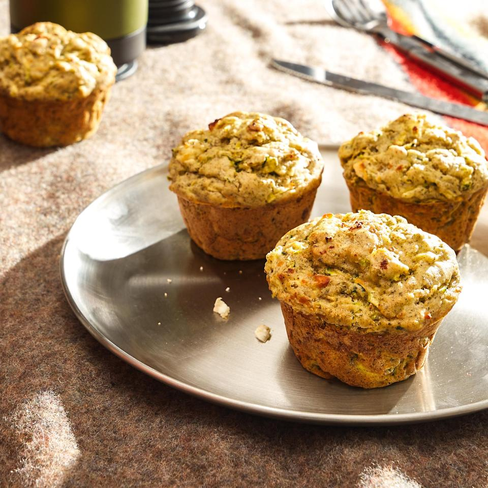 <p>Plenty of shredded zucchini keeps these savory muffins moist. Feta and dill lend them Greek-inspired flavor.</p>