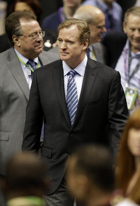 NFL Commissioner Roger Goodell walks on the field before the NFL Super Bowl XLVII football game between the San Francisco 49ers and the Baltimore Ravens Sunday, Feb. 3, 2013, in New Orleans. (AP Photo/Bill Haber)