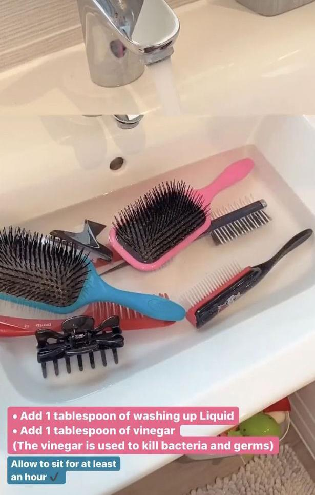 Hairbrushes in the sink being cleaned