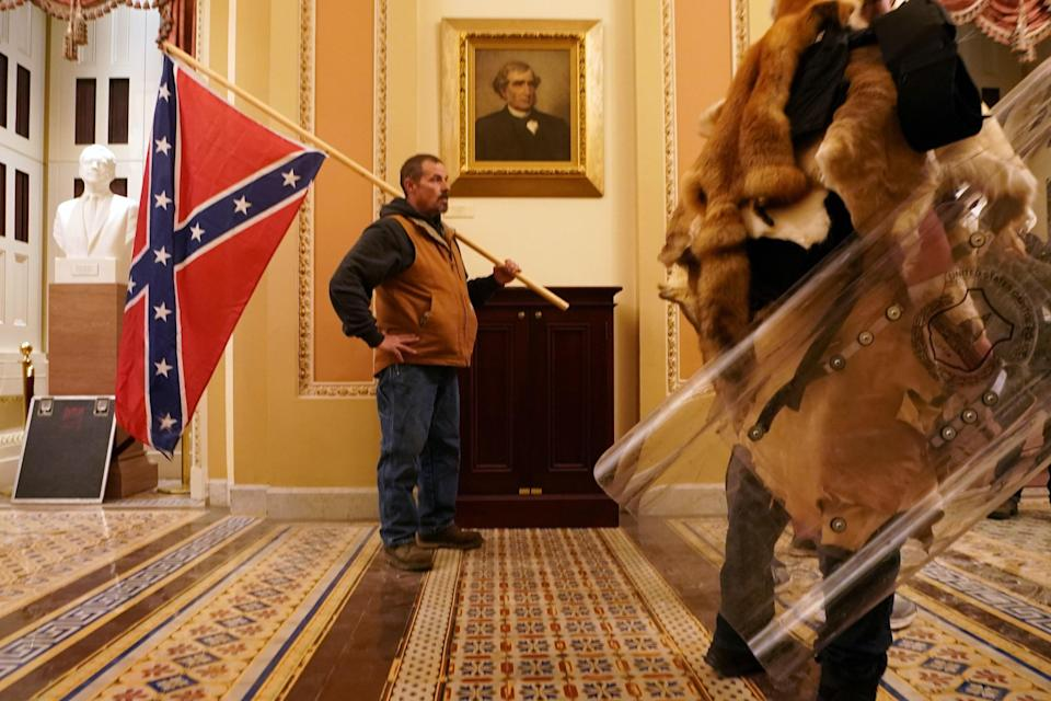 The Confederate flag flies inside the Capitol.