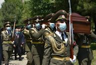 Armenian servicemen carry the coffin of Major Garush Hambardzumyan, who was killed during the clashes