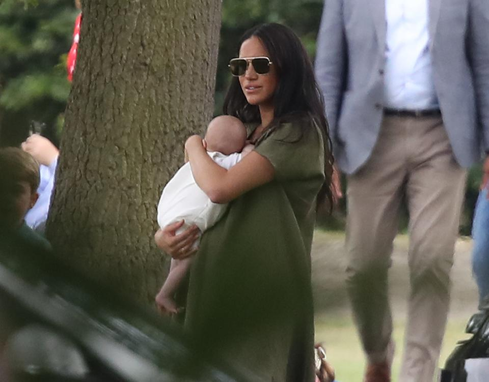 The Duchess of Sussex holding her son Archie as they attend the King Power Royal Charity Polo Day at Billingbear Polo Club, Wokingham, Berkshire.