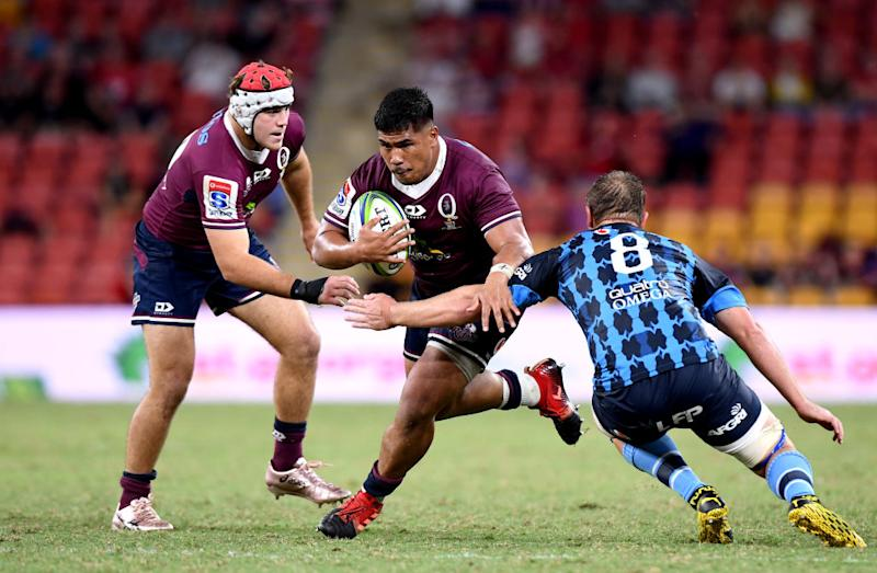 Alex Mafi of the Reds takes on the defence during the round seven Super Rugby match between the Reds and the Bulls in Brisbane, Australia.
