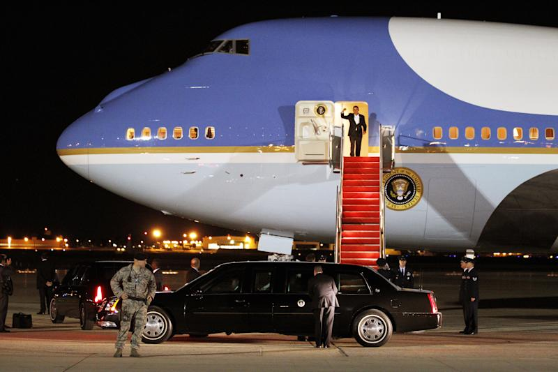 President Barack Obama waves from Air Force One upon arrival at Andrews Air Force Base, Md. on Saturday, Oct. 16,  2010. (AP Photo/Jose Luis Magana)