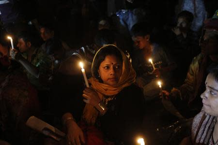 People hold candles as they attend a sit-in protest at Shahbagh intersection demanding capital punishment for Bangladesh's Jamaat-e-Islami senior leader Abdul Quader Mollah in Dhaka