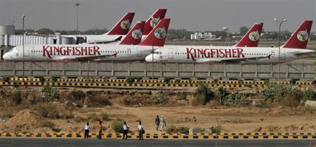Kingfisher Airlines' passenger jets are seen parked at an airport in New Delhi April 12, 2012. REUTERS/Parivartan Sharma/Files