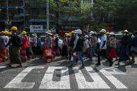 Demonstrators rally against the military coup and to show their support to local residents after riot police officers used teargas to disperse a crowd that held a protest the night before in Yangon's Tamwe neighborhood