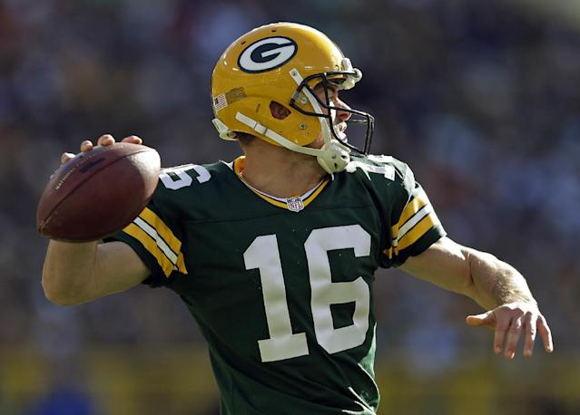 Green Bay Packers' Scott Tolzien drops back to pass during the first half of an NFL football game against the Philadelphia Eagles Sunday, Nov. 10, 2013, in Green Bay, Wis. (AP Photo/Mike Roemer)