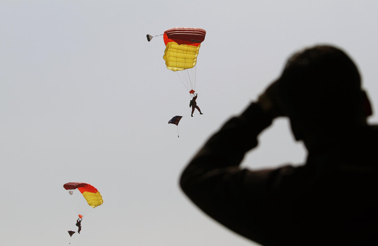 Nepalese army soldiers demonstrate paragliding skills in a parade to mark Army Day in Katmandu, Nepal, Monday, Feb. 20, 2012. Nepal's Army Day is celebrated annually on Mahashivratri, a festival dedicated to Hindu God Shiva. (AP Photo/Niranjan Shrestha)