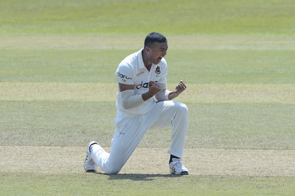 Bangladeshi bowler Taskin Ahmed, celebrates after dismissing Sri Lanka batsman Dimuth Karunaratne, during the fifth day of the first test cricket match between Sri Lanka and Bangladesh in Pallekele, Sri Lanka, Sunday, April 25, 2021. ( AP Photo/Sameera Peiris)