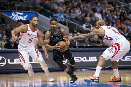FILE PHOTO: Mar 11, 2018; Dallas, TX, USA; Dallas Mavericks guard Yogi Ferrell (11) drives to the basket past Houston Rockets guard Eric Gordon (10) and forward PJ Tucker (4) during the first quarter at the American Airlines Center. Mandatory Credit: Jerome Miron-USA TODAY Sports