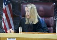 Judge Doneene Loar speaks during an injunction hearing for William Braddock Tuesday, June 22, 2021, in Clearwater, Fla. Anna Paulina Luna, who plans to run for Florida's District 13 seat after losing a race for the slot in 2020 to Democratic U.S. Rep. Charlie Crist, contends in court documents that GOP challenger William Braddock is stalking her and wants her dead. Luna has filed a petition for a permanent restraining order. Braddock denies the claims and wants to see any evidence against him. (Chris Urso/Tampa Bay Times via AP)