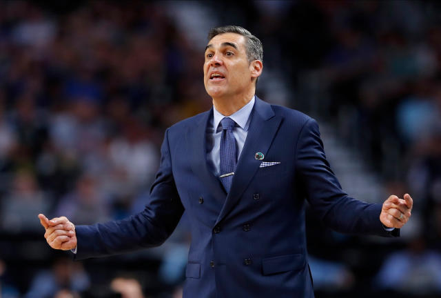 Villanova head coach Jay Wright directs his team during the second half against Kansas in the semifinals of the Final Four NCAA college basketball tournament, Saturday, March 31, 2018, in San Antonio. (AP Photo/Charlie Neibergall)