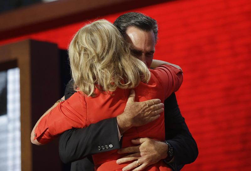 Republican presidential nominee Mitt Romney hugs his wife Ann Romney on stage at the Republican National Convention in Tampa, Fla. on Tuesday, Aug. 28, 2012. (AP Photo/Charles Dharapak)