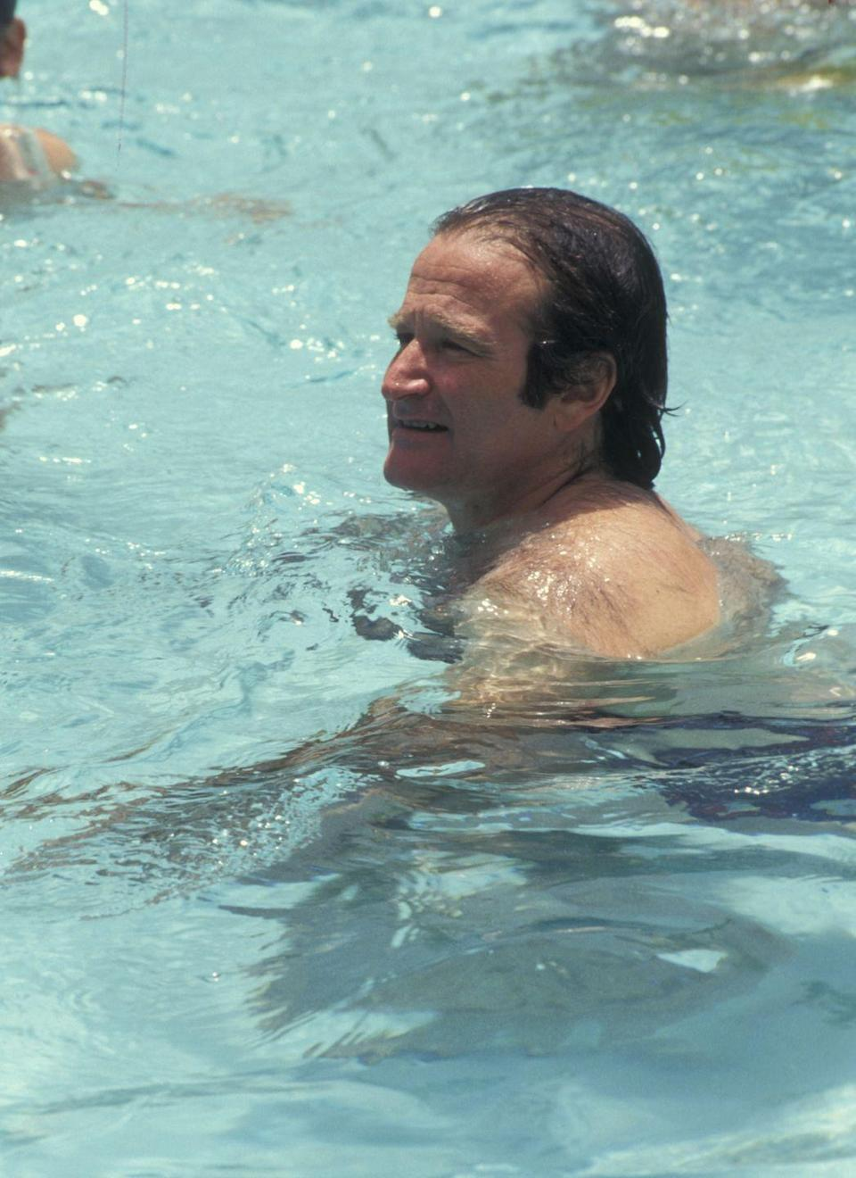 <p>Robin Williams swims at the Westin Rio Beach Resort in San Juan, Puerto Rico.</p><p>Other celebrity visitors this year: Jane Seymour, Ronald Reagan Jr. </p>