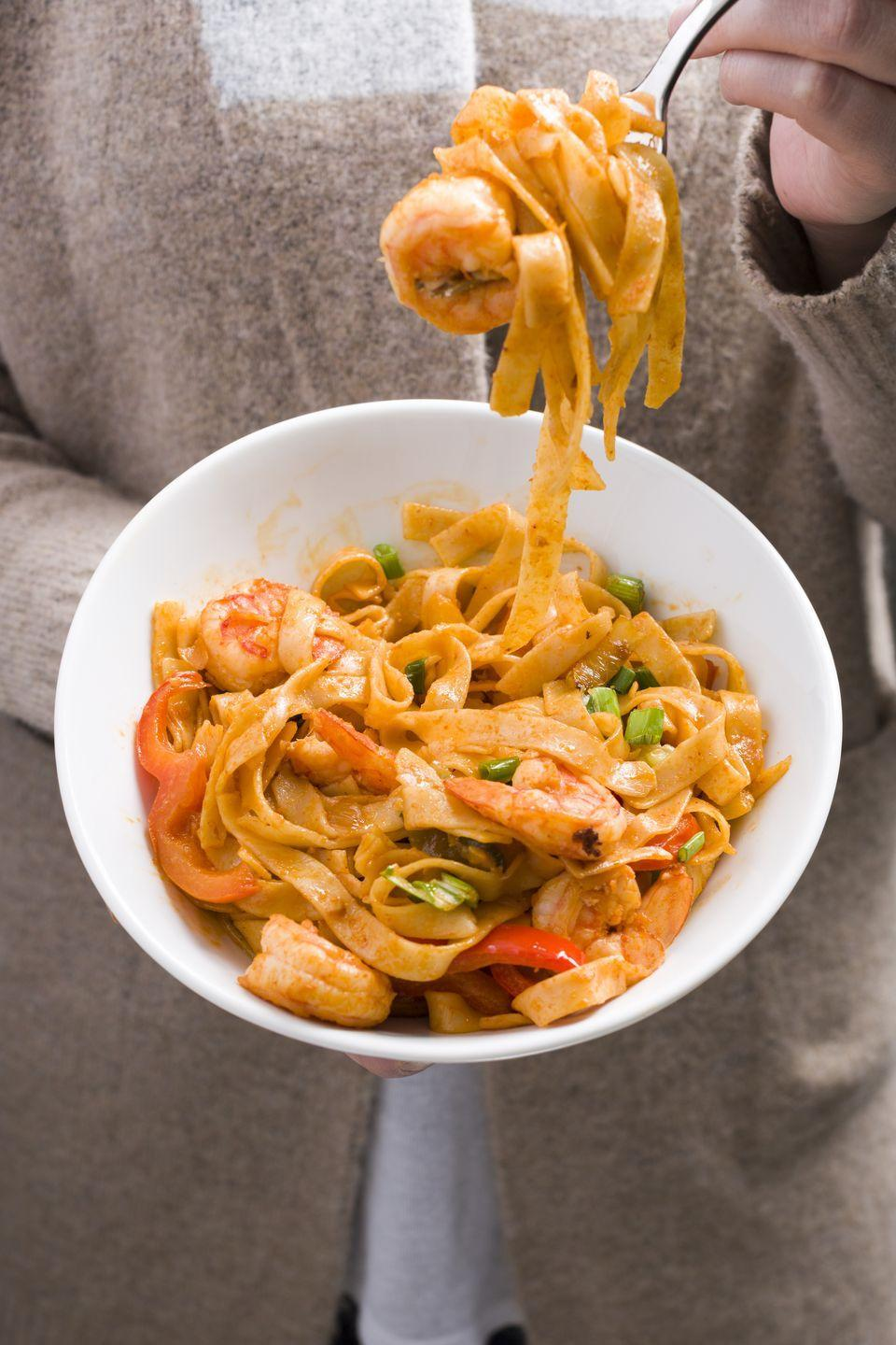 """<p>Judging by the size of that forkful, these shrimp noodles are the bomb.com.</p><p>Get the recipe from <a href=""""https://www.delish.com/cooking/recipe-ideas/recipes/a45479/sriracha-shrimp-noodles-recipe/"""" rel=""""nofollow noopener"""" target=""""_blank"""" data-ylk=""""slk:Delish"""" class=""""link rapid-noclick-resp"""">Delish</a>. </p>"""