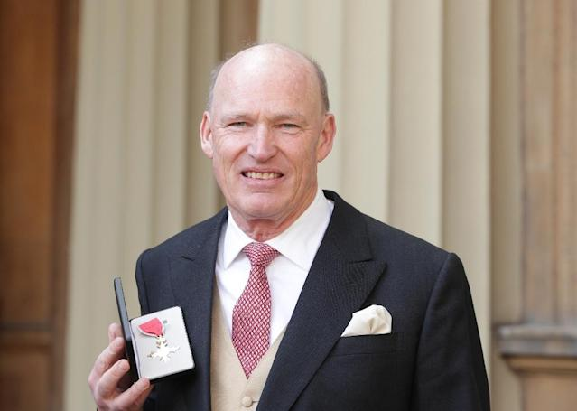 British racehorse trainer John Gosden poses after he was appointed a Officer of the Order of the British Empire (OBE) for services to horseracing and training in March, 2017 (AFP Photo/Yui Mok)