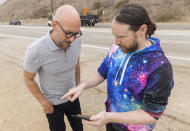 """Author Neil Strauss, left, and Incubus guitarist Mike Einziger, of the podcast """"To Live and Die in LA,"""" appear on Thursday, June 17, 2021, in Malibu, Calif., at the location where the car belonging to Elaine Park was found. Park, who disappeared in 2017, is the subject of the second season of the podcast. (Photo by Willy Sanjuan/Invision/AP)"""