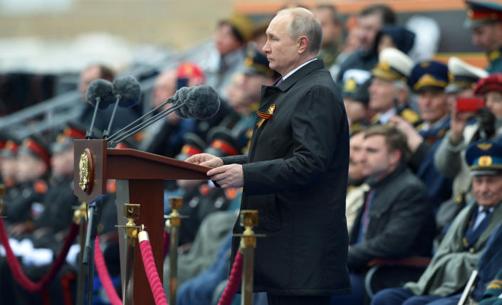 Russian President Vladimir Putin delivers his speech during the Victory Day military parade in Moscow, Russia, Sunday, May 9, 2021, marking the 76th anniversary of the end of World War II in Europe. (Alexei Nikolsky, Sputnik, Kremlin Pool Photo via AP)