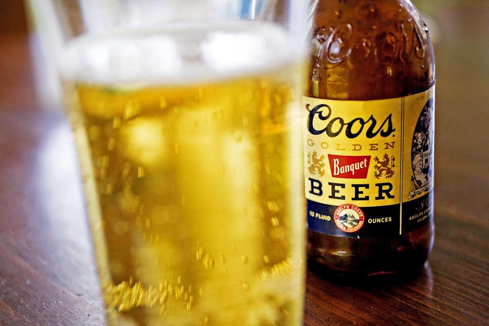 Bottle and glass of Coors Golden Beer