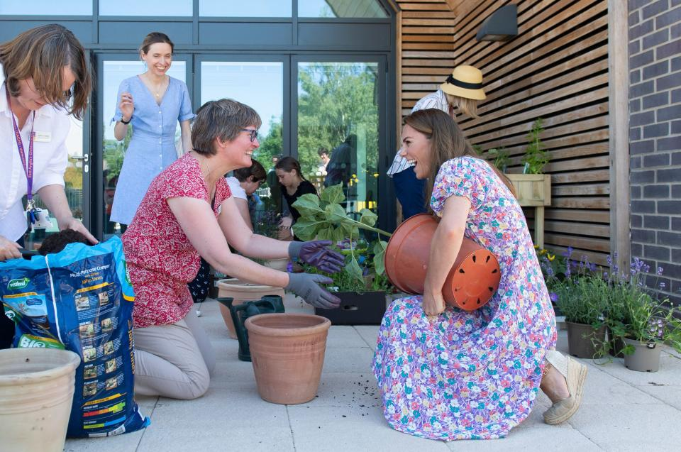 Britain's Catherine, Duchess of Cambridge, helps to pot plants during a visit to The Nook in the village of Framlingham Earl, south of Norwich, eastern England on June 25, 2020, which is one of the three East Anglia Children's Hospices (EACH). - The Duchess is the Royal Patron of the charity which offers care and support for children and young people with life-threatening conditions and their families across Cambridgeshire, Essex, Norfolk and Suffolk. The Duchess of Cambridge on June 25 joined families from East Anglias Childrens Hospices (EACH) to plant a garden using plants purchased during her June 18 visit to Fakenham garden centre. (Photo by Joe Giddens / POOL / AFP) (Photo by JOE GIDDENS/POOL/AFP via Getty Images)