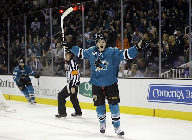 San Jose Sharks' Tomas Hertl, of the Czech Republic, celebrates his third goal of the game against the New York Rangers during the third period of an NHL hockey game on Tuesday, Oct. 8, 2013, in San Jose, Calif. (AP Photo/Marcio Jose Sanchez)