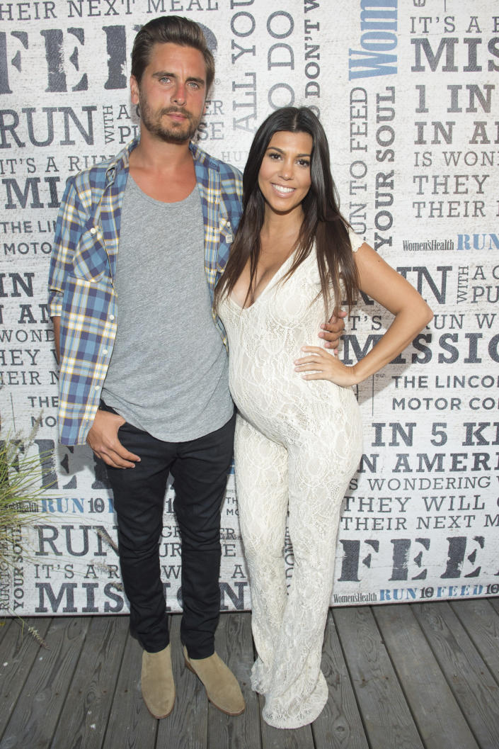 """FILE - Scott Disick and Kourtney Kardashian attend the """"Party Under The Stars"""" benefit on Aug. 9, 2014 in New York. Their reality series """"Keeping Up with the Kardashians"""" will end the series with their 20th season. (Photo by Scott Roth/Invision/AP, File)"""