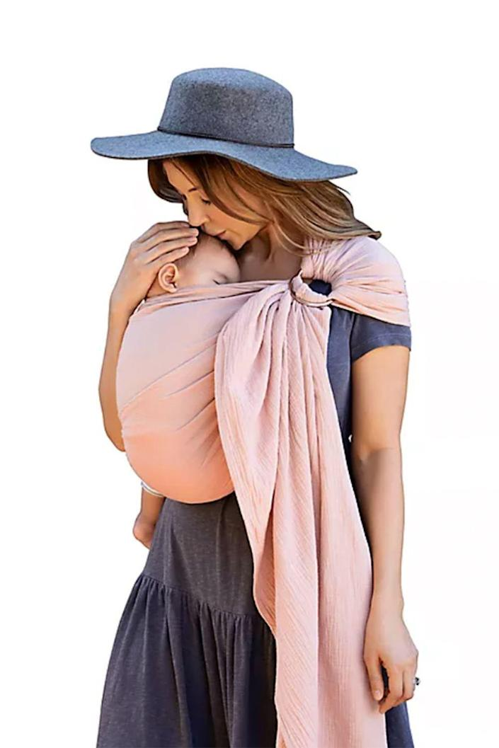 """<p><strong>Moby Wrap</strong></p><p>buybuybaby.com</p><p><strong>$59.99</strong></p><p><a href=""""https://go.redirectingat.com?id=74968X1596630&url=https%3A%2F%2Fwww.buybuybaby.com%2Fstore%2Fproduct%2Fmoby-reg-wrap-ring-sling-baby-carrier%2F5396759&sref=https%3A%2F%2Fwww.oprahdaily.com%2Flife%2Fg26787035%2Fgifts-for-new-moms%2F"""" rel=""""nofollow noopener"""" target=""""_blank"""" data-ylk=""""slk:SHOP NOW"""" class=""""link rapid-noclick-resp"""">SHOP NOW</a></p><p>When you have a brand new baby, sometimes babywearing is the best (and only) way to get anything done. This wrap is safe and comfortable for both mom and baby, plus it's so pretty it doubles as a fashion accessory. </p>"""