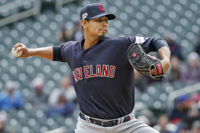 Cleveland Indians' Carlos Carrasco throws to the Minnesota Twins in the first inning of a baseball game Sunday, March 31, 2019, in Minneapolis. (AP Photo/Bruce Kluckhohn)
