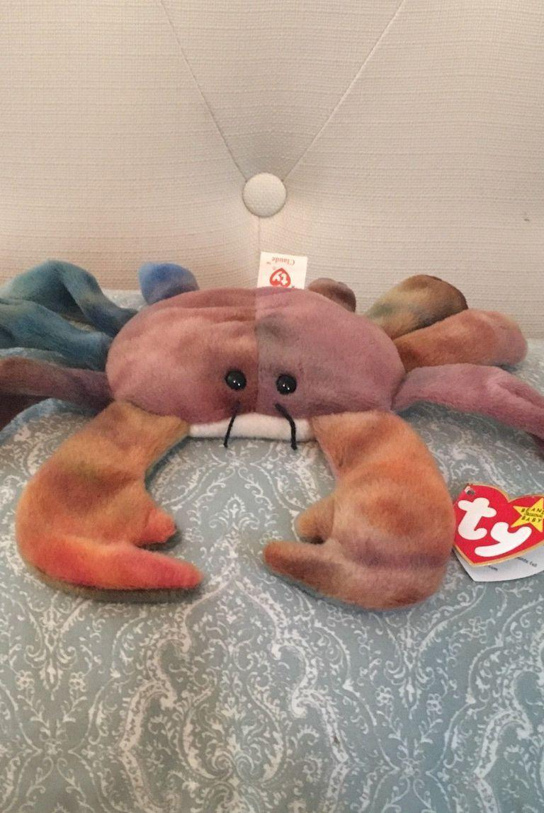 """<p>There are legit people trying (and succeeding?) to sell Claud the Crab for <a href=""""https://www.ebay.com/itm/Claude-the-Crab-Ty-Original-Beanie-Baby-Freckles-Rover-and-Lucky/163560735881?hash=item2614fac489:g:Dz8AAOSwKc9a1PcV"""" rel=""""nofollow noopener"""" target=""""_blank"""" data-ylk=""""slk:$100,000"""" class=""""link rapid-noclick-resp"""">$100,000</a> on eBay. IDEK what to say. Guess now is a good time to recite Claud's poem: """"Claude the crab paints by the sea; a famous artist he hopes to be; but the tide came in and his paints fell; Now his art is on his shell!"""" </p>"""