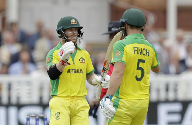 Australia's David Warner, left, celebrates reaching 50 runs with Australia's captain Aaron Finch during the Cricket World Cup match between England and Australia at Lord's cricket ground in London, Tuesday, June 25, 2019. (AP Photo/Matt Dunham)