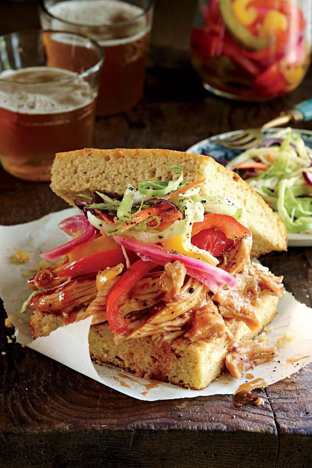 """<p><strong>Recipe: <a href=""""http://www.myrecipes.com/recipe/slow-cooked-barbecued-sandwiches"""" target=""""_blank"""">Slow-cooked Barbecued Chicken Sandwiches</a></strong></p> <p>To make ahead, cool shredded chicken completely. Freeze in an airtight container up to 3 months. Low and slow is how this slow-cooker barbecue chicken gets its flavor. Make a real statement by serving the shredded chicken over <a href=""""http://www.myrecipes.com/recipe/sweet-potato-cornbread-50400000118347/"""" target=""""_blank"""">Sweet Potato Cornbread</a> and topping with <a href=""""http://www.myrecipes.com/recipe/pickled-peppers-onions-50400000118348/"""" target=""""_blank"""">Pickled Peppers & Onions</a> and <a href=""""http://www.myrecipes.com/recipe/simple-slaw-50400000118352/"""" target=""""_blank"""">Simple Slaw</a>.</p>"""