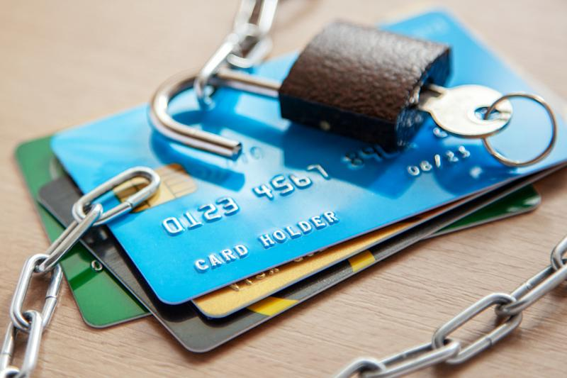 Stack of credit cards with lock and chain on top