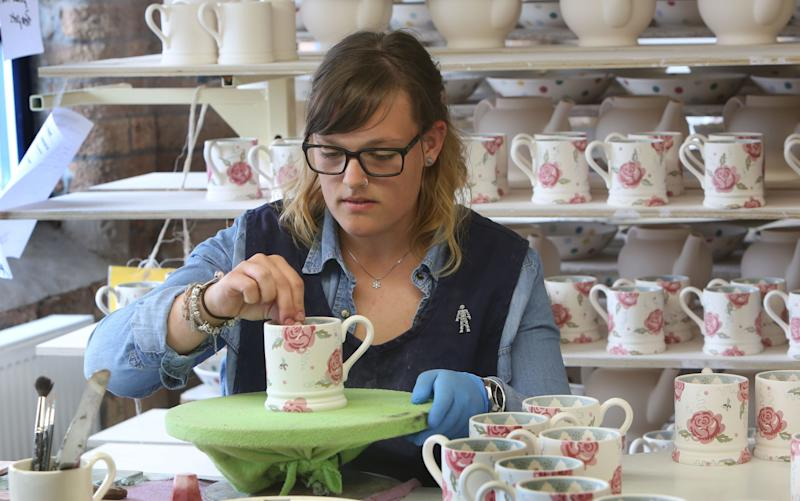 Trainee Jenna Barcroft, at the Emma Bridgewater pottery factory, Stoke-on-Trent  - Credit: Martin Pope