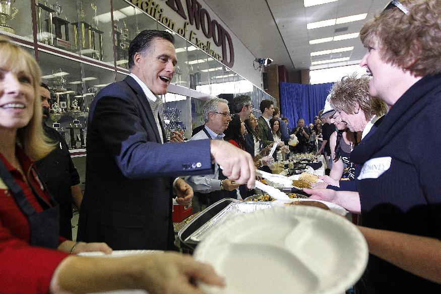 Republican presidential candidate, former Massachusetts Gov. Mitt Romney serves food a pancake breakfast at Brookwood High School in Brookwood, Ga., Sunday, March 4, 2012. (AP Photo/Gerald Herbert)