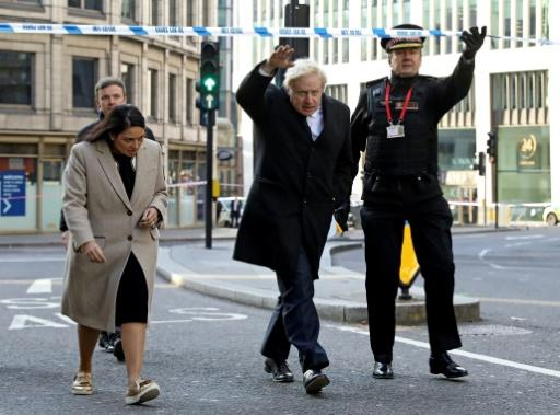 Prime Minister Boris Johnson, (C) raised concerns about the effectiveness of de-radicalisation programmes in and out of jail after police shot dead an extremist on early release from prison who stabbed two people