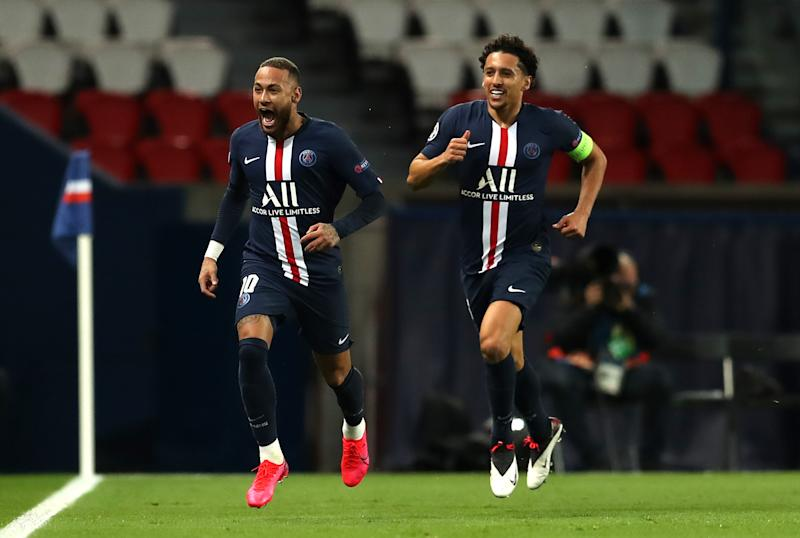 PARIS, FRANCE - MARCH 11: (FREE FOR EDITORIAL USE) In this handout image provided by UEFA, Neymar of Paris Saint-Germain celebrates with Marquinhos after scoring his team's first goal during the UEFA Champions League round of 16 second leg match between Paris Saint-Germain and Borussia Dortmund at Parc des Princes on March 11, 2020 in Paris, France. The match is played behind closed doors as a precaution against the spread of COVID-19 (Coronavirus). (Photo by UEFA - Handout/UEFA via Getty Images)