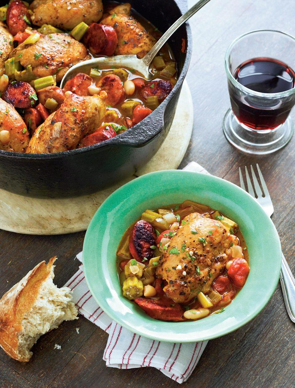 """<p><strong>Recipe: <a href=""""https://www.southernliving.com/syndication/cajun-chicken-cassoulet"""" rel=""""nofollow noopener"""" target=""""_blank"""" data-ylk=""""slk:Cajun Chicken Cassoulet"""" class=""""link rapid-noclick-resp"""">Cajun Chicken Cassoulet</a></strong></p> <p>Our Southern take on the classic French dish includes Cajun smoked sausage and okra, and it comes together much quicker than the original for a weeknight-friendly spin.</p>"""