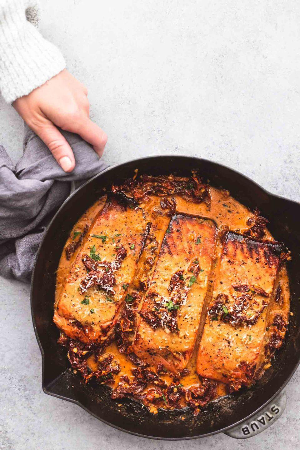 """<p>Serve up a rich, indulgent meal that won't leave you feeling overly full afterwards. </p><p><strong>Get the recipe at <a href=""""https://www.lecremedelacrumb.com/salmon-in-creamy-sun-dried-tomato-sauce/"""" rel=""""nofollow noopener"""" target=""""_blank"""" data-ylk=""""slk:Creme de la Crumb"""" class=""""link rapid-noclick-resp"""">Creme de la Crumb</a>.</strong> </p><p><a class=""""link rapid-noclick-resp"""" href=""""https://www.amazon.com/Victoria-Skillet-Seasoned-Flaxseed-Certified/dp/B01726HD72/?tag=syn-yahoo-20&ascsubtag=%5Bartid%7C10050.g.1115%5Bsrc%7Cyahoo-us"""" rel=""""nofollow noopener"""" target=""""_blank"""" data-ylk=""""slk:SHOP SKILLETS"""">SHOP SKILLETS</a></p>"""