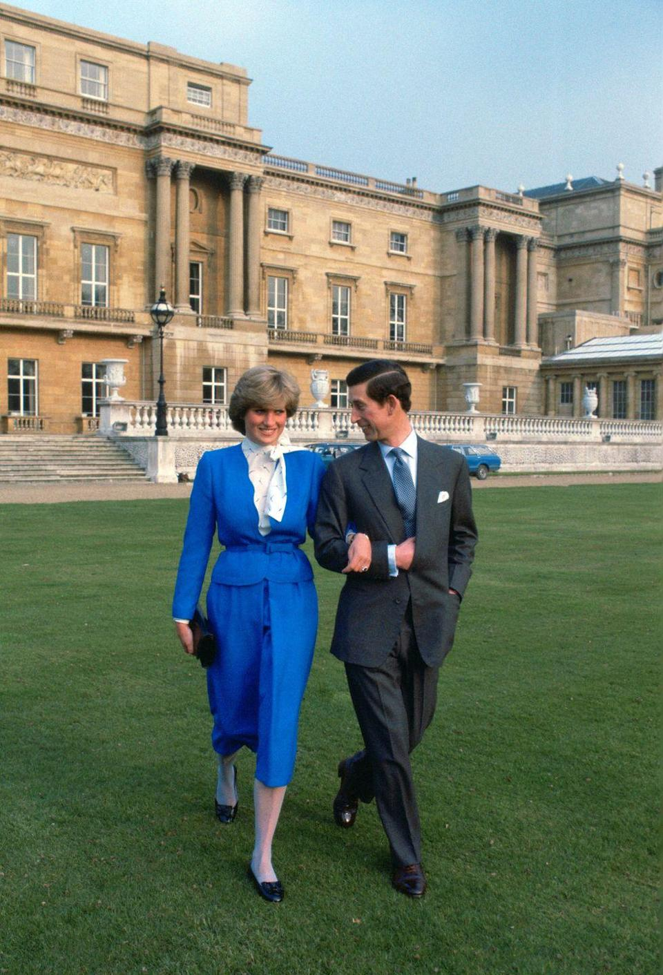 <p>The engagement photographs were taken outside at Buckingham Palace.</p>