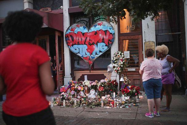 PHOTO: People congregate around a memorial to those killed in Sunday morning's mass shooting on Aug. 6, 2019 in Dayton, Ohio. (Scott Olson/Getty Images)