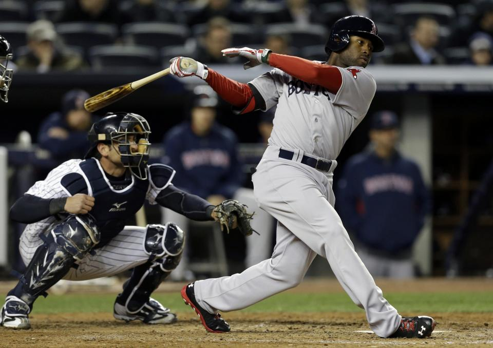 Boston Red Sox's Jackie Bradley, right, hits a seventh-inning RBI double against the New York Yankees in a baseball game at Yankee Stadium in New York, Thursday, April 4, 2013. (AP Photo/Kathy Willens)