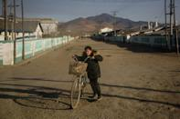 """Leader Kim Jong Un told officials to embark on an """"arduous march"""", alluding to the 1990s famine that killed hundreds of thousands, to ease the impact of the pandemic on the North Korean people"""