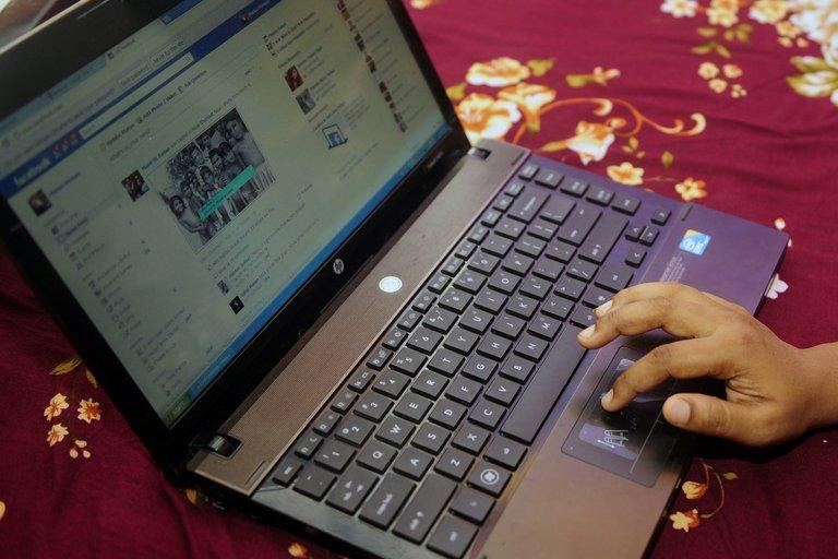 A Bangladeshi woman logs onto social networking website Facebook on her laptop in Dhaka on May 15, 2012