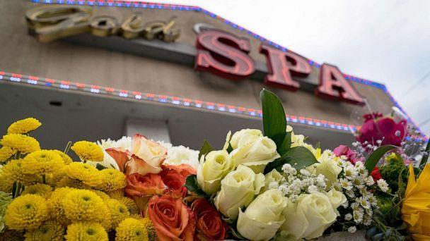 PHOTO: Flowers adorn Gold Spa during a demonstration against violence towards women and Asians following Tuesday night's shooting in which three women were gunned down  in Atlanta, March 18, 2021. (Megan Varner/Getty Images)
